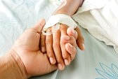 34753824-mother-holding-child-s-hand-who-fever-patients-have-iv-tube.jpg